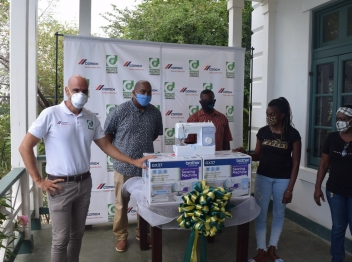 Carib Cement donates sewing machines to community groups